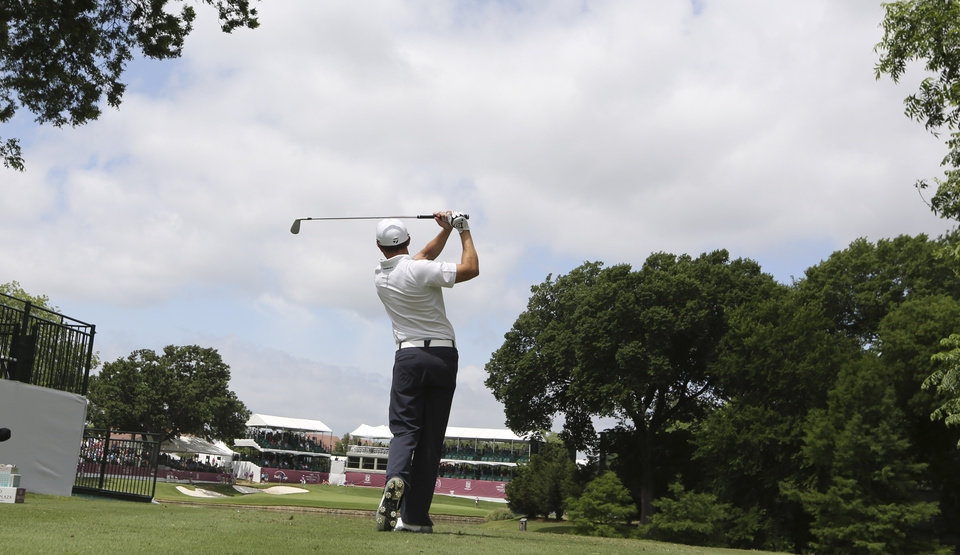 Photo - Tim Wilkinson watches his tee shot on the 13th hole during the first round of the PGA Colonial golf tournament in Fort Worth, Texas, Thursday, May 22, 2014. (AP Photo/LM Otero)