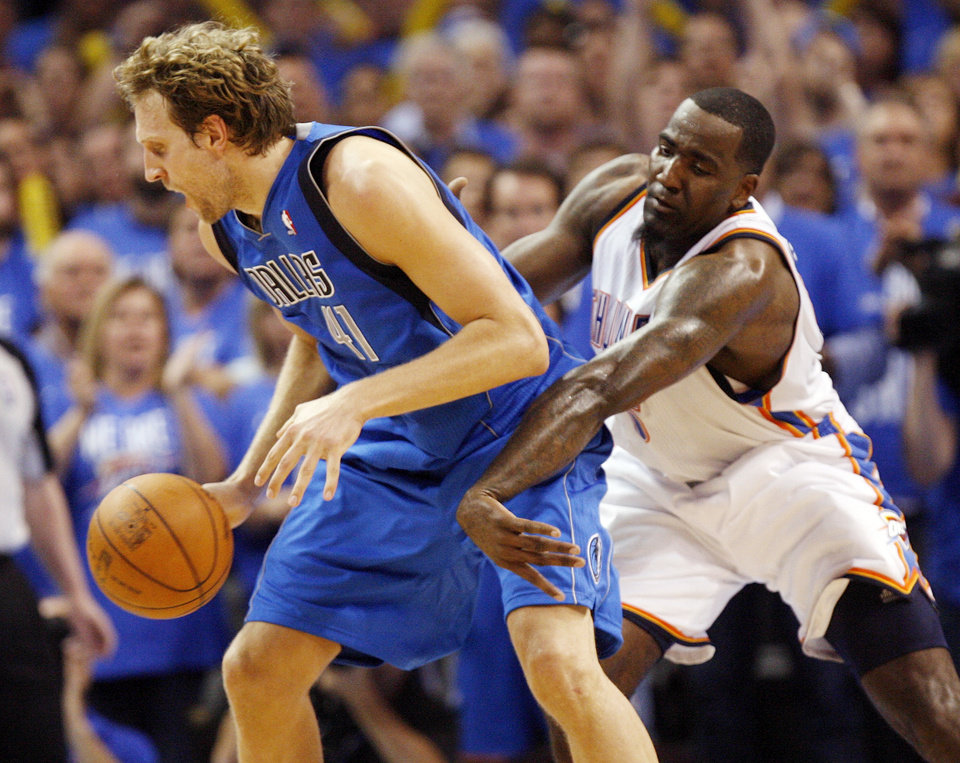 Photo - Oklahoma City's Kendrick Perkins (5) knocks the ball away from Dallas' Dirk Nowitzki (41) in the fourth quarter during game one of the first round in the NBA playoffs between the Oklahoma City Thunder and the Dallas Mavericks at Chesapeake Energy Arena in Oklahoma City, Saturday, April 28, 2012. Oklahoma City won, 99-98. Photo by Nate Billings, The Oklahoman
