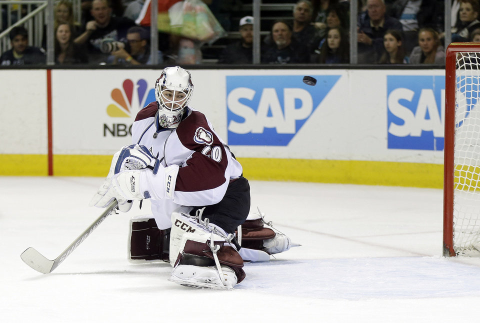 Photo - Colorado Avalanche goalie Reto Berra, of Switzerland, is beaten for a goal  on a shot from San Jose Sharks' Patrick Marleau during the first period of an NHL hockey game on Friday, April 11, 2014, in San Jose, Calif. (AP Photo/Marcio Jose Sanchez)