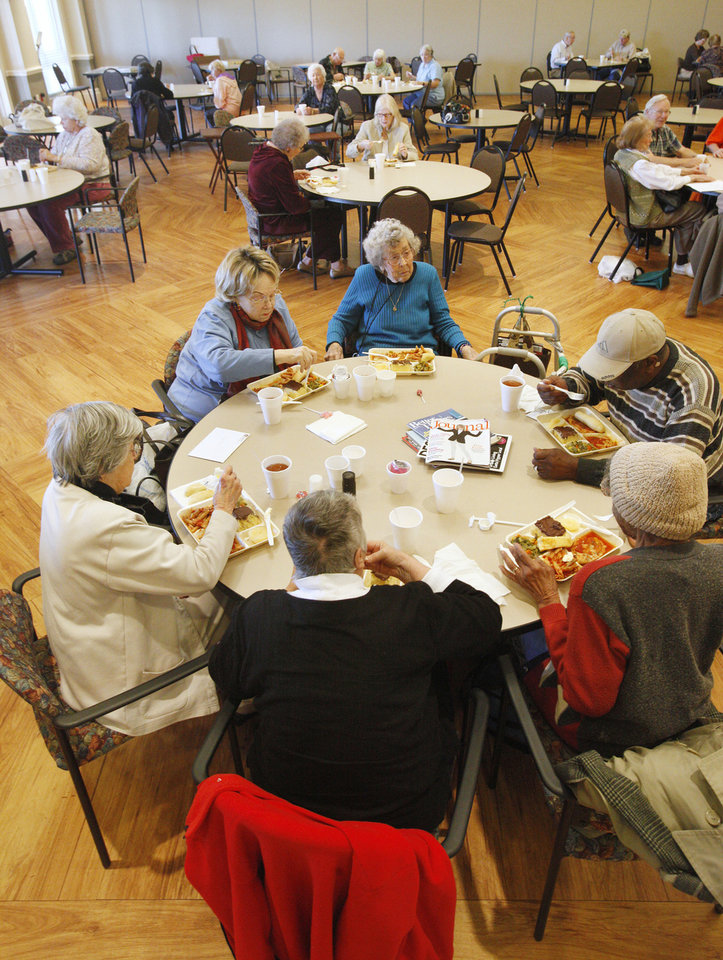 Photo - Participants eat lunch at the Edmond Senior Center  in Mitch Park Tuesday. The meal gives seniors a chance to eat and socialize with others.  PAUL B. SOUTHERLAND - PAUL B. SOUTHERLAND