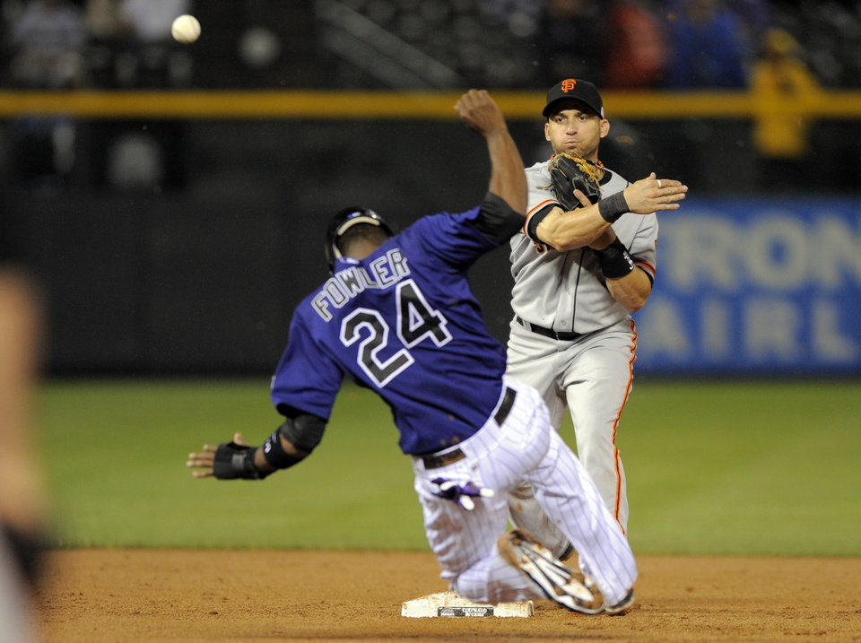Photo -   San Francisco Giants third baseman Marco Scutaro forces out Colorado Rockies' Dexter Fowler (24) during the third inning of a baseball game Tuesday, Sept. 11, 2012, in Denver. (AP Photo/Jack Dempsey)