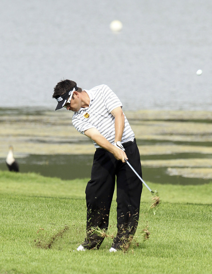 Photo - South African golfer Louis Oosthuizen, plays an approach shot on the 17th fairway, during the second day of the Nedbank Golf Challenge at the Gary Player Country Club in Sun City, South Africa on Friday Nov. 30, 2012. (AP Photo/Themba Hadebe)