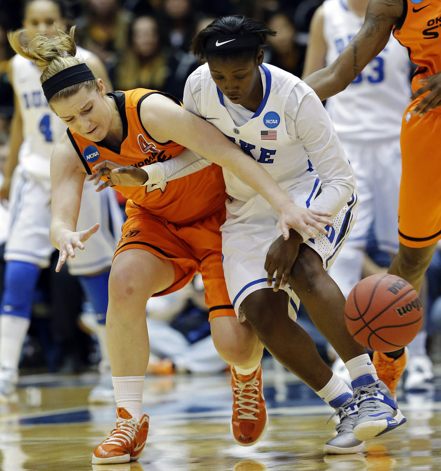 Duke's Alexis Jones, right, and Oklahoma State's Liz Donohoe chase a loose ball during the first half of a second-round game in the women's NCAA college basketball tournament in Durham, N.C., Tuesday, March 26, 2013. (AP Photo/Gerry Broome)