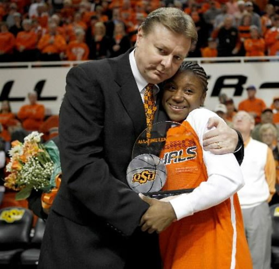 Photo - OSU coach Kurt Budke hugs Andrea Riley during senior night before the NCAA women's college basketball game between Oklahoma State University and Iowa State at Gallagher-Iba Arena in Stillwater, Okla., Wednesday, March 3, 2010. Photo by Bryan Terry