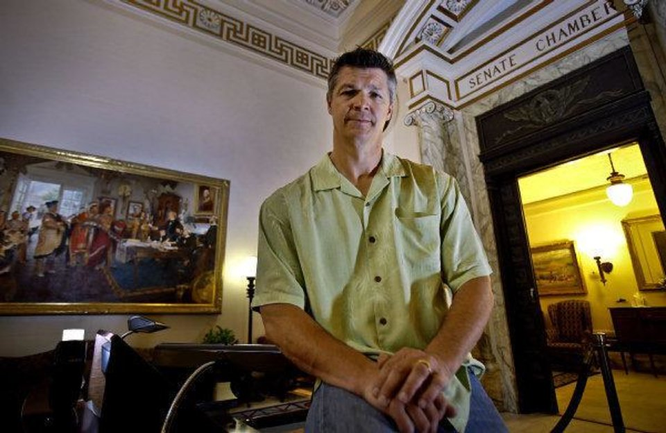 Former state senator Brooks Douglass poses for a photo outside the Senate Chambers at the Oklahoma State Capitol on Sept. 1 in Oklahoma City. <strong>CHRIS LANDSBERGER - CHRIS LANDSBERGER</strong>