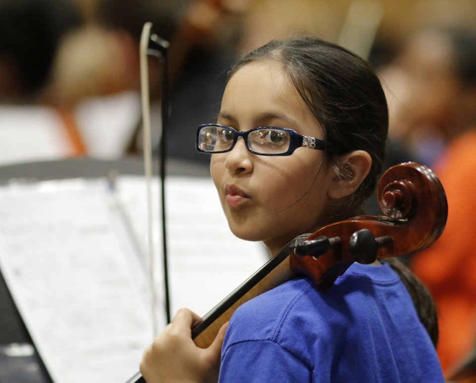 Photo -  Rubi Rojas listens to instructions as the El Sistema Oklahoma youth orchestra performs its last concert of the year at St. Luke's United Methodist Church, 222 NW 15. Photo by Doug Hoke, The Oklahoman   DOUG HOKE -