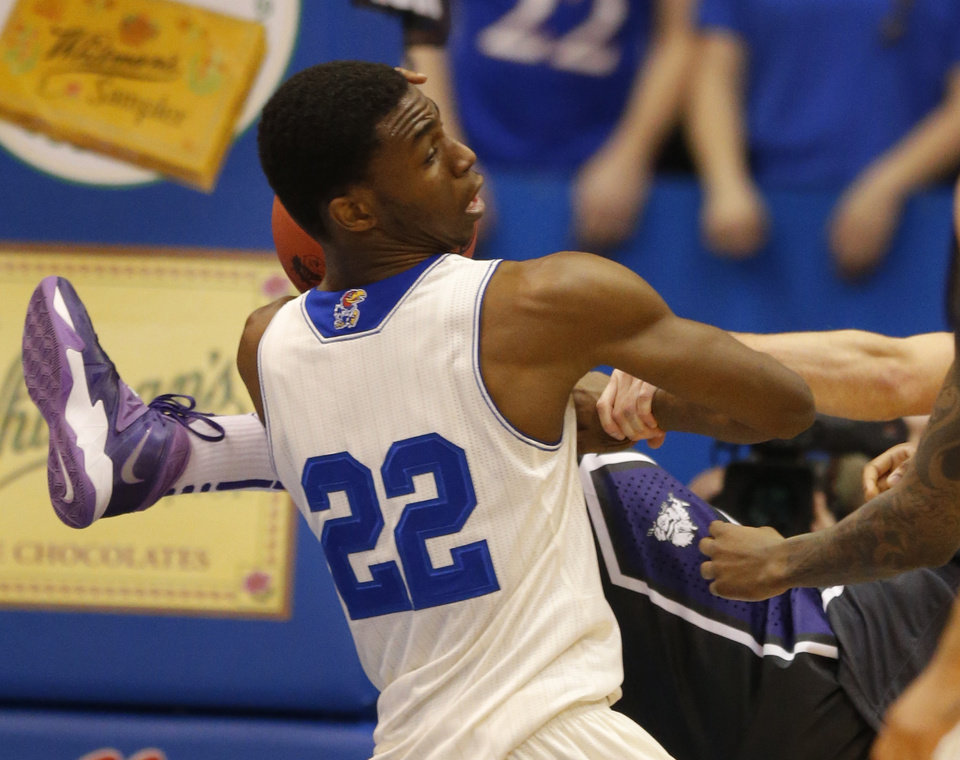 Photo - Kansas guard Andrew Wiggins (22) rebounds during the first half of an NCAA college basketball game against TCU in Lawrence, Kan., Saturday, Feb. 15, 2014. (AP Photo/Orlin Wagner)