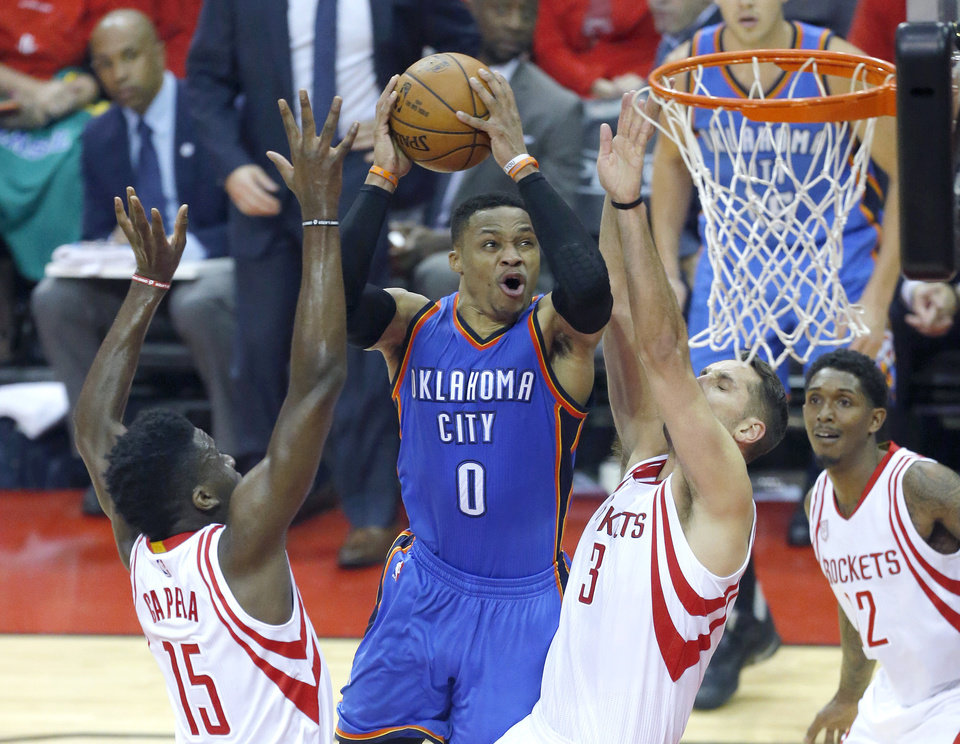 Photo - Oklahoma City's Russell Westbrook (0) goes to the basket as Houston's Clint Capela (15) and Ryan Anderson (3) defend during Game 5 in the first round of the NBA playoffs between the Oklahoma City Thunder and the Houston Rockets in Houston, Texas,  Tuesday, April 25, 2017.  Houston won 105-99. Photo by Sarah Phipps, The Oklahoman