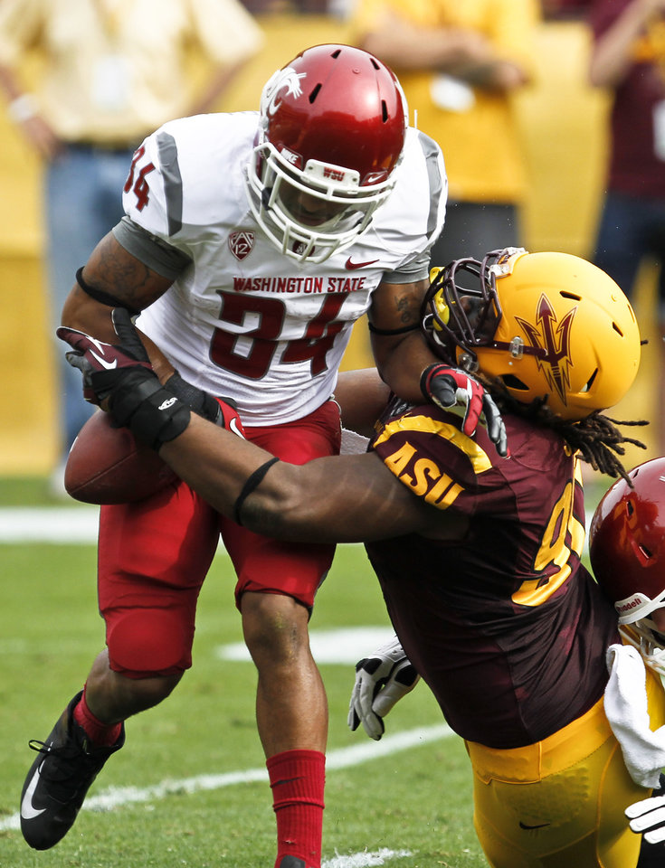 Photo -   Arizona State's Will Sutton, right, strips the ball from Washington State's Teondray Caldwell (34) during the first half in a football game Saturday, Nov. 17, 2012, in Tempe, Ariz. Caldwell was able to recover his own fumble on the play, but Arizona State defeated the Washington State 46-7.(AP Photo/Ross D. Franklin)