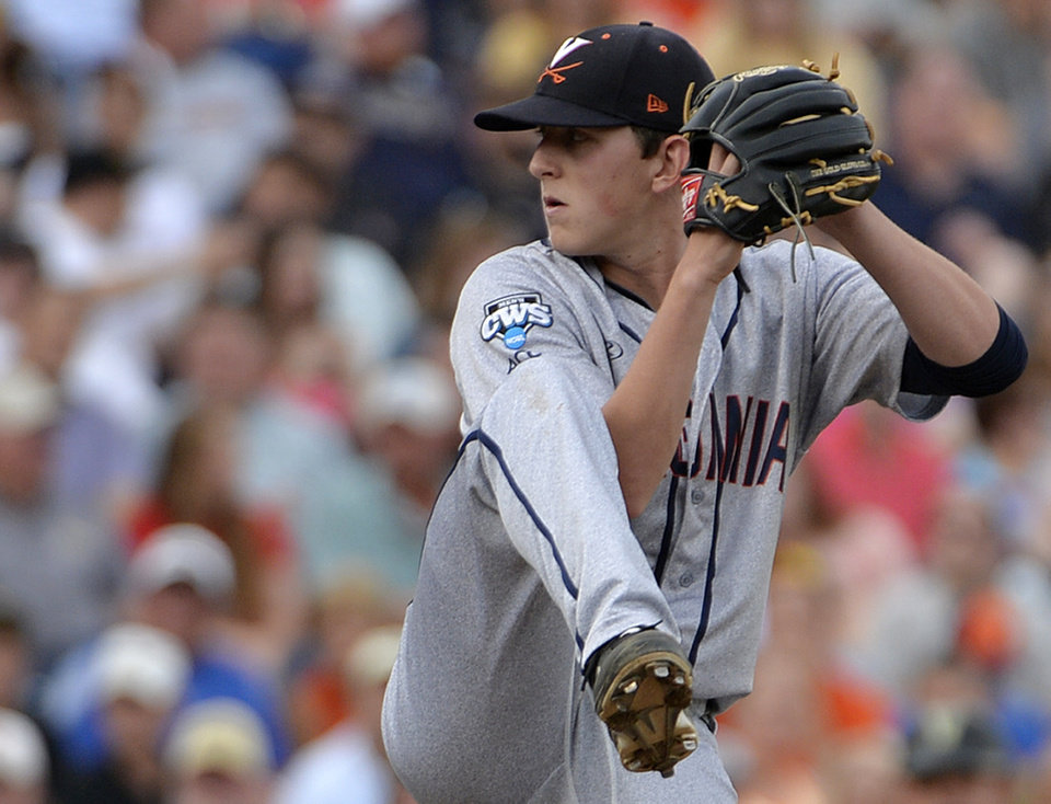 Photo - Virginia pitcher Brandon Waddell winds up duirng the second inning of Game 2 of the best-of-three NCAA baseball College World Series finals against Vanderbilt in Omaha, Neb., Tuesday, June 24, 2014. (AP Photo/Ted Kirk)