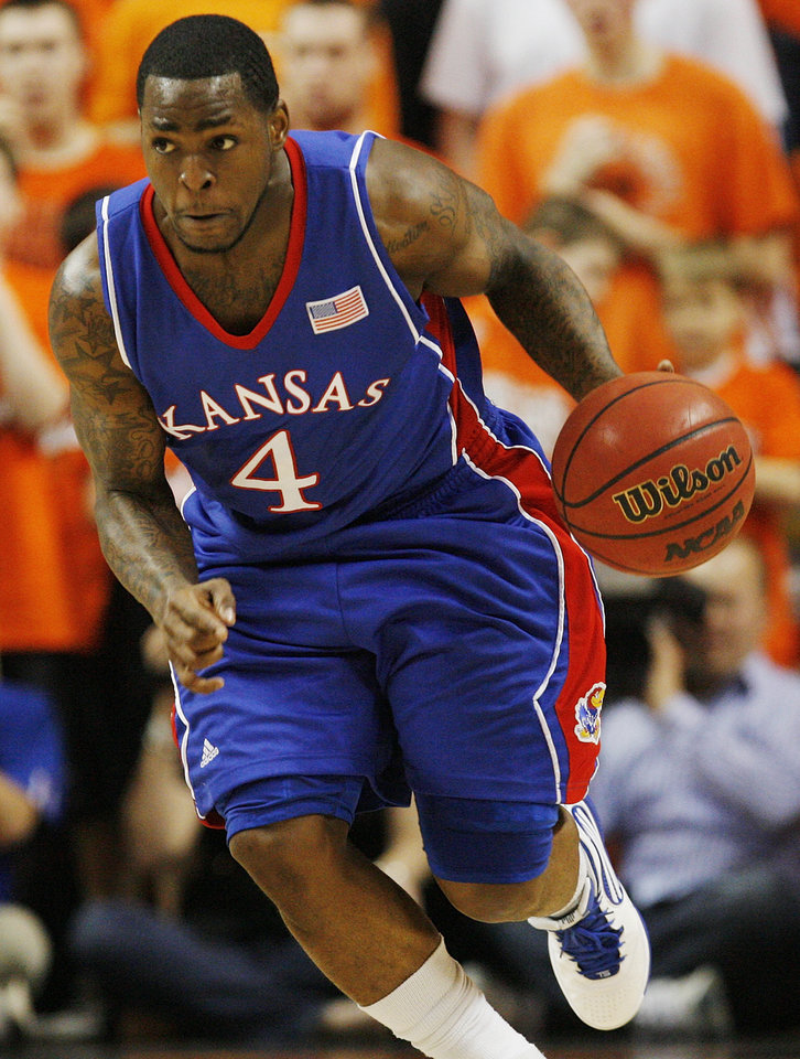 Sherron Collins (4) of KU dribbles the ball in the second half during the men\'s college basketball game between the University of Kansas (KU) and Oklahoma State University (OSU) at Gallagher-Iba Arena in Stillwater, Okla., Saturday, Feb. 27, 2010. OSU won, 85-77. Photo by Nate Billings, The Oklahoman