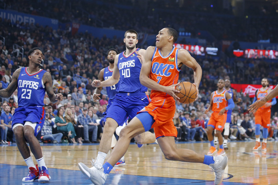 Photo - Oklahoma City's Darius Bazley (7) drives to the basket during an NBA basketball game between the Oklahoma City Thunder and the LA Clippers at Chesapeake Energy Arena in Oklahoma City, Sunday, Dec. 22, 2019. [Bryan Terry/The Oklahoman]
