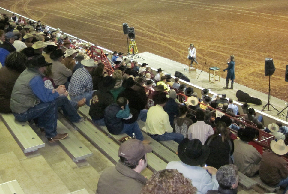 Photo - Susie McEntire Eaton, on stage in white, during Cowboy Church before the final round of the 2011 Timed Event Championship of the World at the Lazy E in Guthrie. Photo Provided