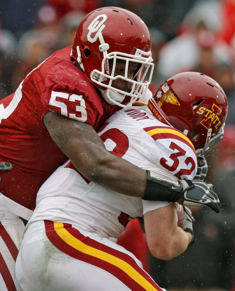 Oklahoma\'s Casey Walker (53) brings down Iowa State\'s Jeff Woody (32) during a college football game between the University of Oklahoma Sooners (OU) and the Iowa State University Cyclones (ISU) at Gaylord Family-Oklahoma Memorial Stadium in Norman, Okla., Saturday, Nov. 26, 2011. Photo by Bryan Terry, The Oklahoman