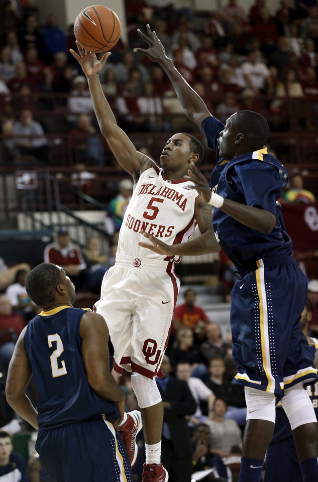 Sooner Je\'lon Hornbeak shoots guarded by June Carter (32) as the University of Oklahoma (OU) Sooners men\'s basketball team plays the Central Oklahoma Bronchos at McCasland Field House on Wednesday, Nov. 7, 2012 in Norman, Okla. Photo by Steve Sisney, The Oklahoman