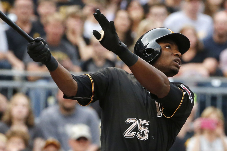 Photo - Pittsburgh Pirates' Gregory Polanco (25) watches his fly out to right field off Chicago Cubs starting pitcher Travis Wood during the first inning of a baseball game in Pittsburgh Tuesday, June 10, 2014. It was Polanco's first at-bat in the major leagues.  (AP Photo/Gene J. Puskar)