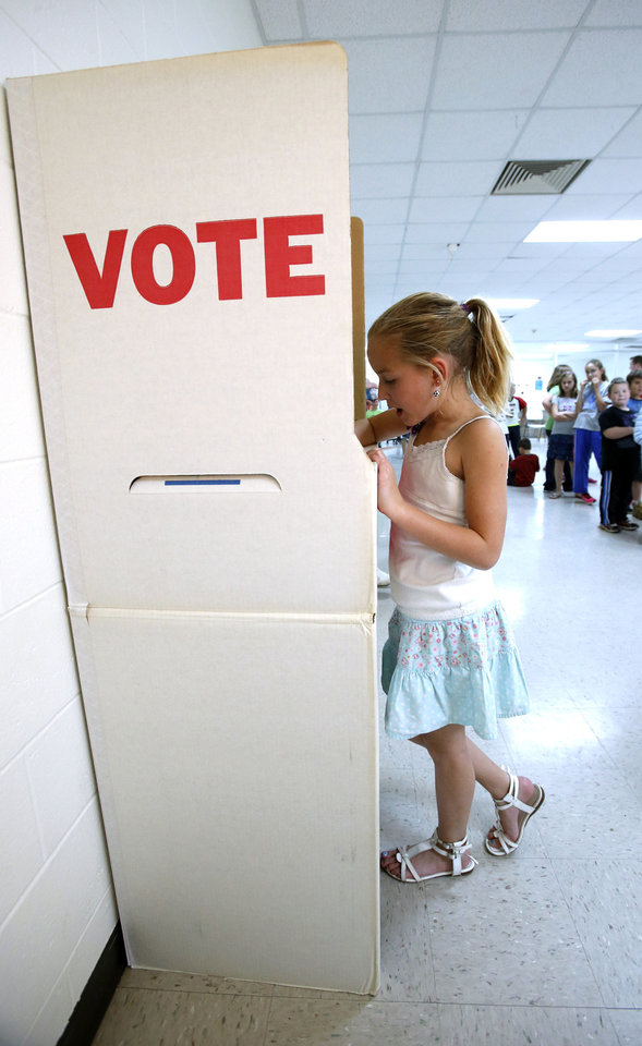 Kaylee Gent, 8, cast her ballot during the YMCA kids election at Greenbriar Program Center on Tuesday, Oct. 30, 2012 in Oklahoma City, Okla. Photo by Steve Sisney, The Oklahoman