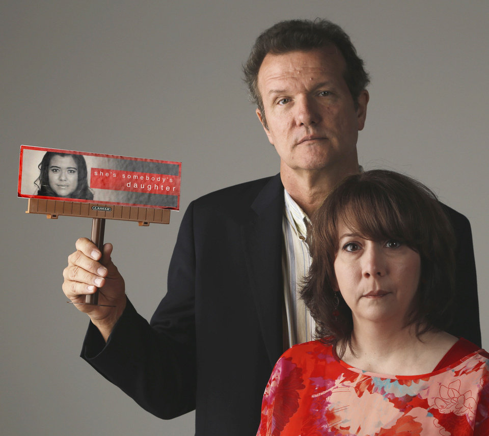 "Tammy Stauffer and Steve Siler holds a billboard replica from the ""She's somebody's daughter"" anti-pornography campaign at OPUBCO studio Monday, October 3, 2013. Photo by Doug Hoke, The Oklahoman"