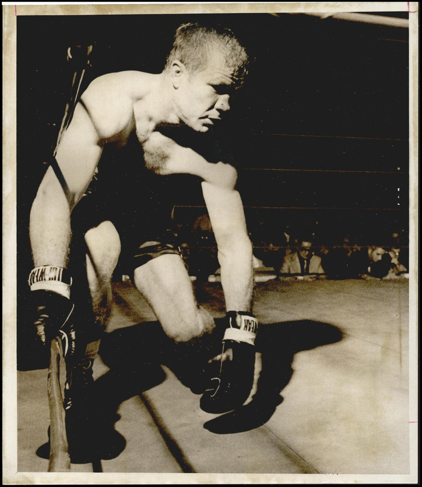 Photo -  Oklahoma boxer Brian Kelly faced an uphill battle in a 1971 world championship bout against the venerable Bob Foster. Even though Kelly was the crowd favorite that night at State Fair Arena, the Oklahoma City fans couldn't carry him to victory. Foster won in a third-round technical knockout. [OKLAHOMAN ARCHIVES]