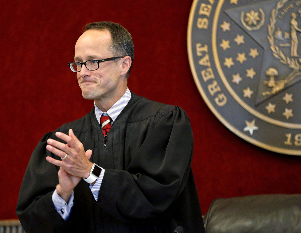 Photo -  Special Judge Michael Tupper applauds graduates Thursday during Drug Court Graduation in the Cleveland County Courthouse. [Photo by Steve Sisney, The Oklahoman]