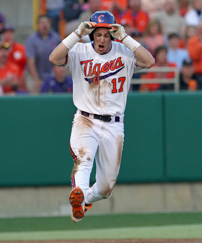 Photo - Clemson's Steve Wilkerson reacts after a ball hit down the first-base line was called foul by umpire David Brown during an NCAA college baseball game against South Carolina on Sunday, Mar. 2, 2014 in Clemson, S.C. (AP Photo/Anderson Independent-Mail, Mark Crammer) GREENVILLE NEWS OUT; SENECA JOURNAL OUT