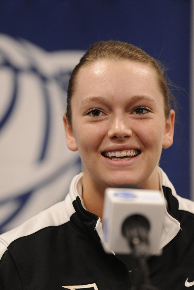 Photo - Army's Jen Hazlett smiles as she answers a question during a news conference at the NCAA women's college basketball tournament, Saturday, March 22, 2014. in College Park, Md. Army plays Maryland in a first-round game on Sunday. (AP Photo/Gail Burton)