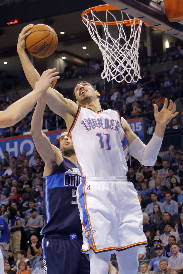Photo - Oklahoma City's Enes Kanter (11) pulls in a rebound over Dallas' Salah Mejri (50) during the NBA basketball game between the Oklahoma City Thunder and the Dallas Mavericks at Chesapeake Energy Arena on Wednesday, Jan. 13, 2016, in Oklahoma City, Okla.  Photo by Chris Landsberger, The Oklahoman