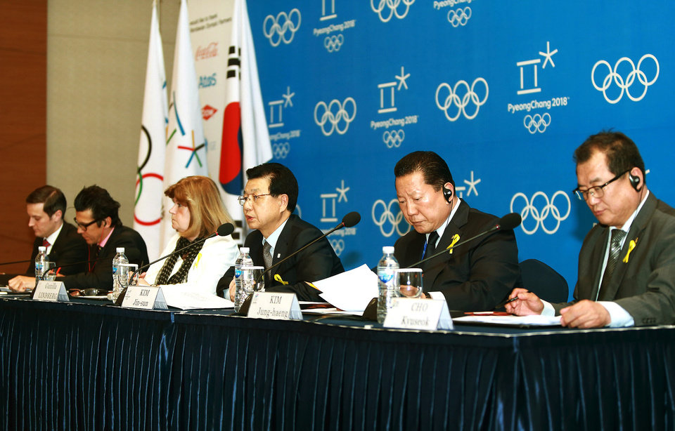 Photo - Kim Jin-sun, head of the Pyeongchang Organizing Committee for the 2018 Winter Olympic Games, third from right, speaks during a press conference as Gunilla Lindberg, third from left, chair of the IOC Evaluation Commission, listens in Pyeongchang, South Korea, Thursday, May 1, 2014.  The IOC is convinced that preparations for the 2018 Winter Games in Pyeongchang are on track, in contrast with concerns over the chronic construction delays for the 2016 Olympics in Rio de Janeiro. (AP Photo/Yonhap)  KOREA OUT
