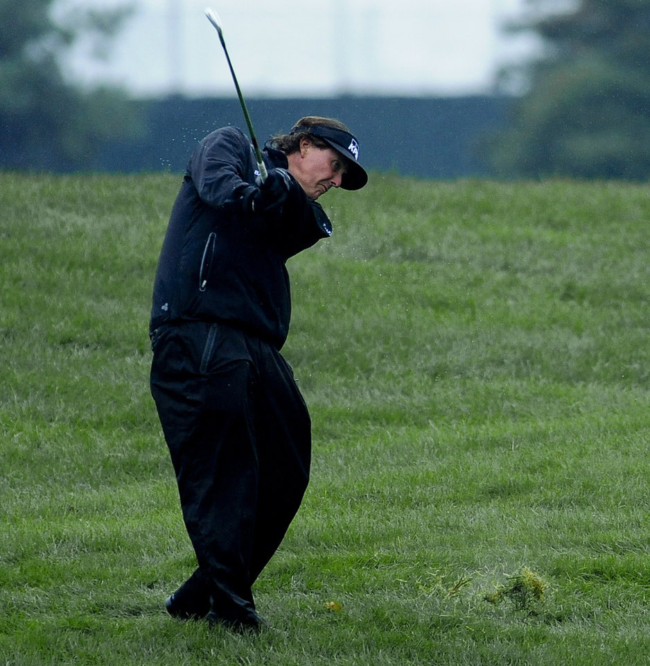 Photo - Phil Mickelson hits from the rough on the first hole during the final round of the BMW Championship golf tournament at Conway Farms Golf Club in Lake Forest, Ill., Sunday Sept. 15, 2013. (AP Photo/Matt Marton)
