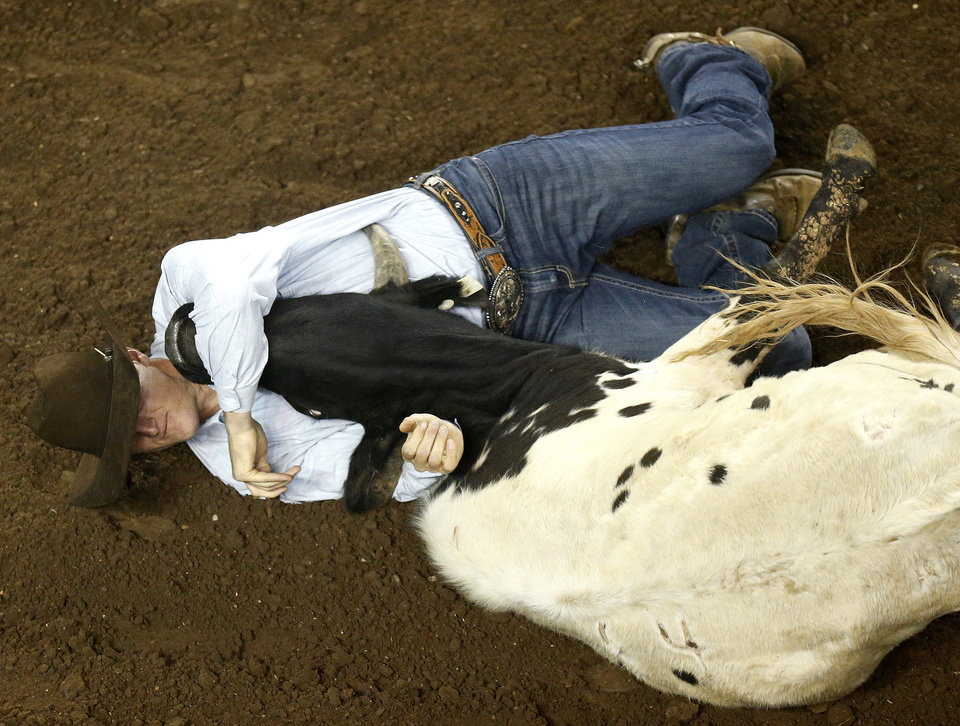 Sean Santucci participates in the steer wrestling at the National Circuit Finals Rodeo at the State Fair Arena in Oklahoma City, Friday, April 5, 2013. Photo by Sarah Phipps, The Oklahoman