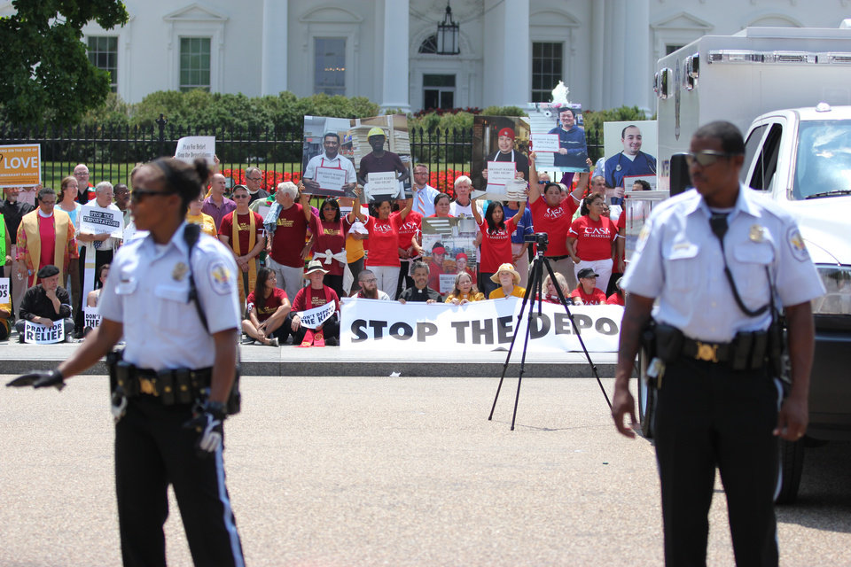 Photo - Faith leaders and activists participate in a demonstration in front of the White House in Washington, Thursday, July 31, 2014, asking President Barack Obama to modify his deportations policies. (AP Photo/Connor Radnovich)