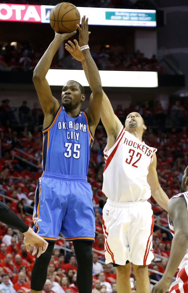 Oklahoma Citys\'s Kevin Durant shoots the ball as Houston\'s Francisco Garcia defends during Game 4 in the first round of the NBA playoffs between the Oklahoma City Thunder and the Houston Rockets at the Toyota Center in Houston, Texas, Monday, April 29, 2013. Photo by Bryan Terry, The Oklahoman