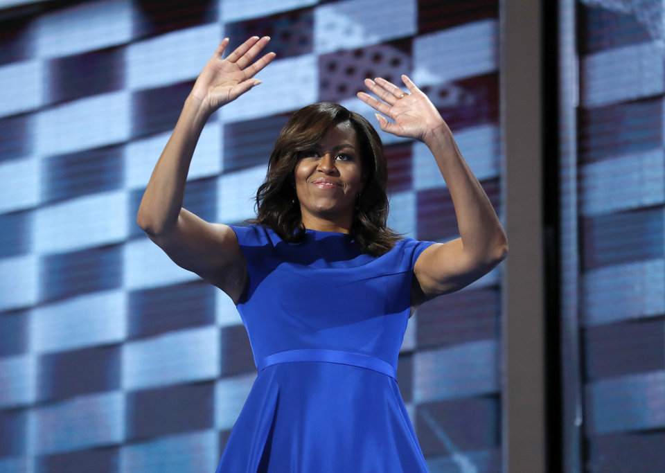 Photo - First Lady Michelle Obama waves after speaking to delegates during the first day of the Democratic National Convention in Philadelphia , Monday, July 25, 2016. (AP Photo/Carolyn Kaster)