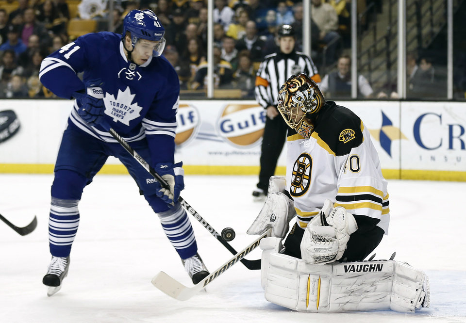 Toronto Maple Leafs' Nikolai Kulemin looks for a rebound in front of Boston Bruins goalie Tuukka Rask of Finland during the first period of an NHL hockey game in Boston on Monday, March 25, 2013. (AP Photo/Winslow Townson)