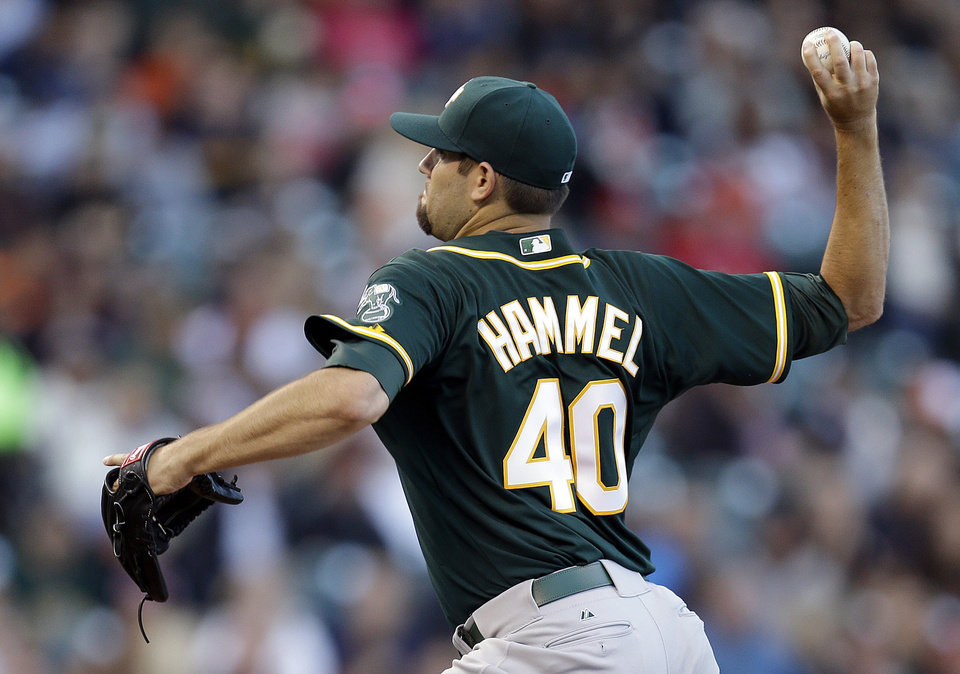 Photo - Oakland Athletics' Jason Hammel works against the San Francisco Giants in the first inning of a baseball game Wednesday, July 9, 2014, in San Francisco. (AP Photo/Ben Margot)
