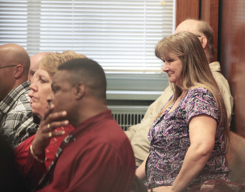 Photo - Justin Adams' mother Tina Clark at his preliminary hearing, Wednesday, April 3, 2013. Adams is facing manslaughter charges after prosecutors reduced murder charges in his pregnant wife's death.  David McDaniel