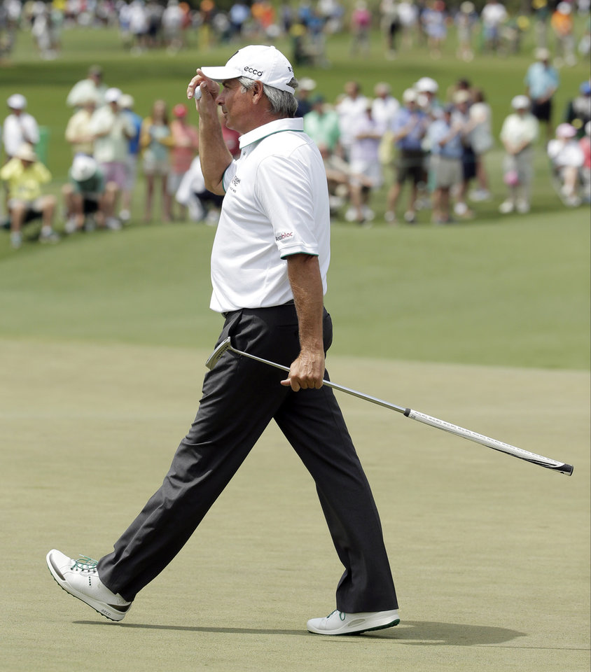 Photo - Fred Couples tips his cap after a birdie putt on the second hole during the second round of the Masters golf tournament Friday, April 11, 2014, in Augusta, Ga. (AP Photo/Chris Carlson)