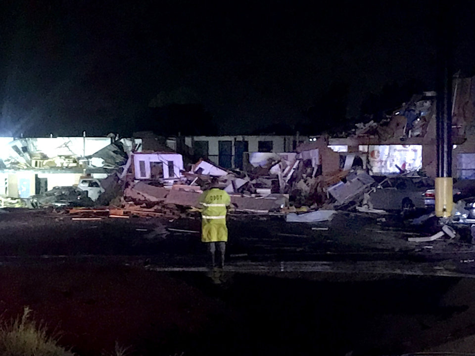 Photo - Tornado damage is pictured at  the American Budget Value Inn in El Reno, Okla., Sunday, May 26, 2019.  [Chris Landsberger/The Oklahoman]
