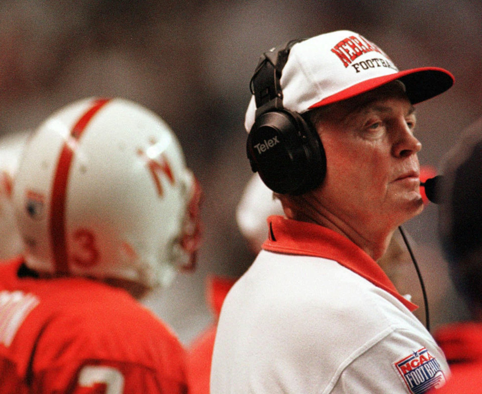 Photo - FILE - In this Dec. 6, 1997 file photo, Nebraska football coach Tom Osborne watches his team win the Big 12 conference championship NCAA college football game 54-15 over Texas A&M in San Antonio. Osborne will retire as Nebraska's athletic director on Jan. 1, 2013, and end an association with the university that began in 1962. (AP Photo/Eric Gay, File)
