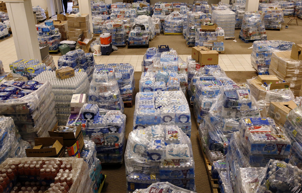 Photo -  Hundreds of pallets of bottled water and an ample supply of food, clothing and toiletries are stored at the Salvation Army warehouse in the former JC Penney's Store at the old Crossroads Mall, now called Plaza Mayor at the Crossroads. Photo  by Jim Beckel, The Oklahoman.  Jim Beckel - THE OKLAHOMAN