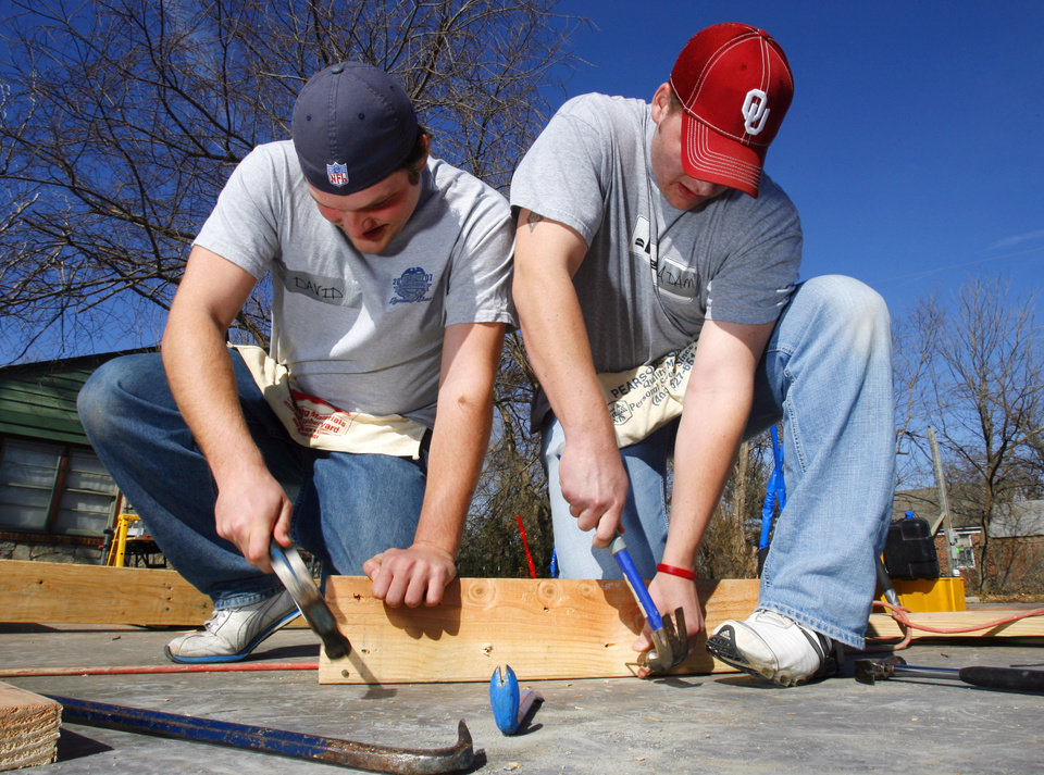 David Schones, Norman junior, and Adam Cooley, Oklahoma City sophomore build a header as volunteers and Habitat for Humanity staff raise walls for a home at 313 W Himes in Norman, Okla. on Friday, Feb. 6, 2009.   Photo by Steve Sisney, The Oklahoman