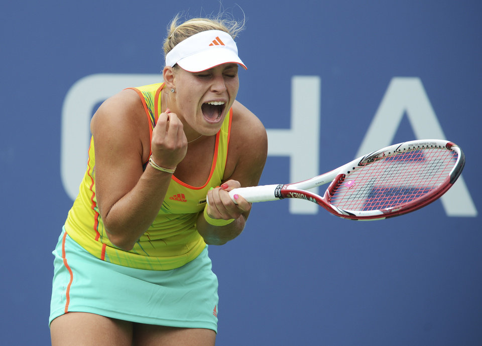 Photo -   Germany's Angelique Kerber reacts during her match against Italy's Sara Errani in the fourth round of play at the 2012 US Open tennis tournament, Monday, Sept. 3, 2012, in New York. (AP Photo/Henny Ray Abrams)