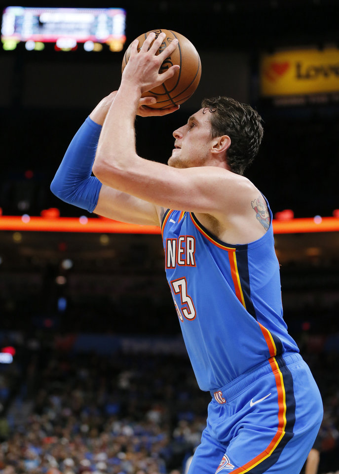 Photo - Oklahoma City's Mike Muscala (33) shoots in the second quarter during an NBA basketball game between the Oklahoma City Thunder and the Washington Wizards at Chesapeake Energy Arena in Oklahoma City, Friday, Oct. 25, 2019. [Nate Billings/The Oklahoman]