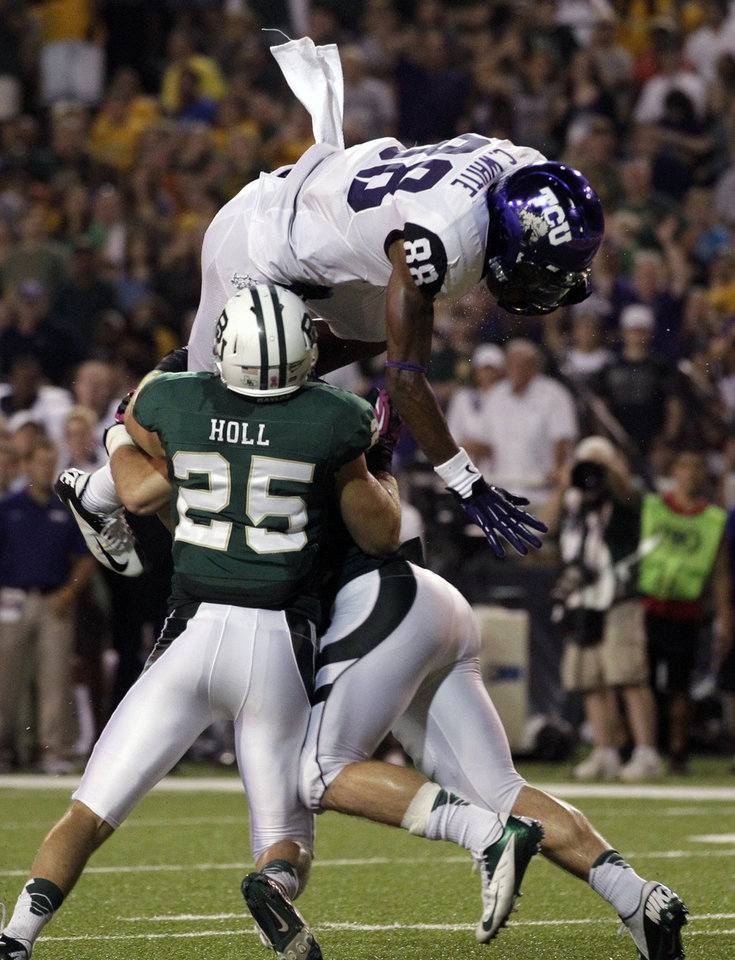 Photo -   Baylor safety Sam Holl (25) and Bryce Hager, right, stop TCU 's Cam White (88) from entering the end zone after making a reception in the second half of an NCAA college football game on Saturday, Oct. 13, 2012, in Waco, Texas. TCU went on to defeat Baylor 49-21. (AP Photo/Tony Gutierrez)