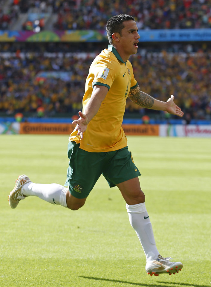Photo - Australia's Tim Cahill celebrates after scoring his side's first goal during the group B World Cup soccer match between Australia and the Netherlands at the Estadio Beira-Rio in Porto Alegre, Brazil, Wednesday, June 18, 2014.   (AP Photo/Wong Maye-E)