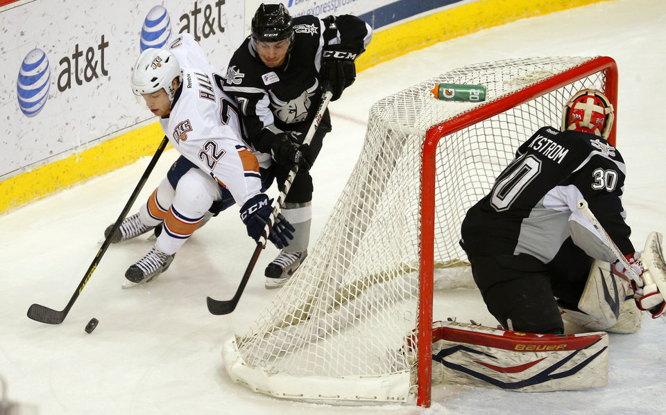 Taylor Hall of the Oklahoma City Barons tries to get around Greg Rallo of the San Antonio Rampage as Jacob Markstrom guards the goal during an AHL hockey game at the Cox Convention Center in Oklahoma City, Friday, Dec. 28, 2012. Photo by Bryan Terry, The Oklahoman