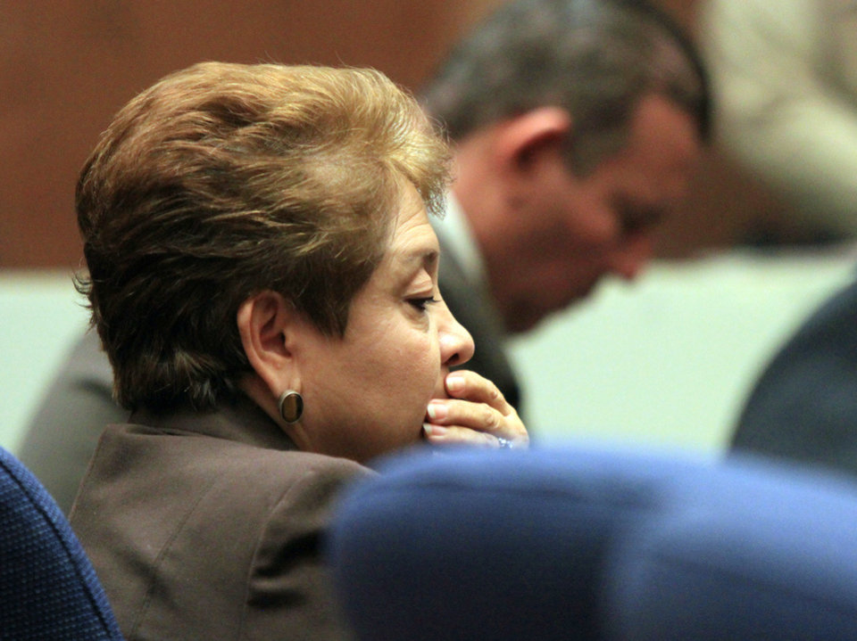 Photo - Teresa Jacobo, a former Bell City elected official listens to the judge as a guilty verdict is read in her trial on Wednesday, March 20, 2013, in Los Angeles.  Jacobo and four former elected officials were convicted of multiple counts of misappropriation of public funds, and a sixth defendant was cleared entirely. Former Mayor Oscar Hernandez and co-defendants Jacobo, George Mirabal, George Cole, and Victor Belo were all convicted of multiple counts and acquitted of others.  The charges against them involved paying themselves inflated salaries of up to $100,000 a year in the city of 36,000 people, where one in four residents live below the poverty line.   (AP Photo/Los Angeles Times, Irfan Khan, Pool)