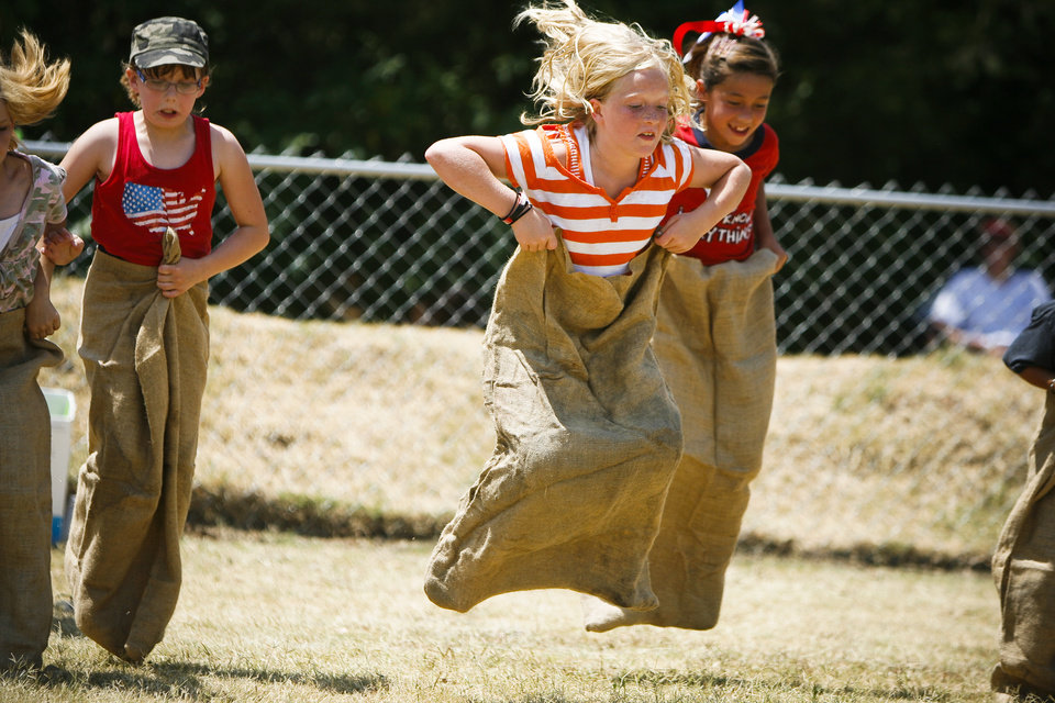 Makenna Spruce, 9, from McLoud takes the lead in a potato sack race at the 2011 Blackberry Festival in McLoud, Okla. on Saturday, July 2, 2011. Photo by Zach Gray, The Oklahoman