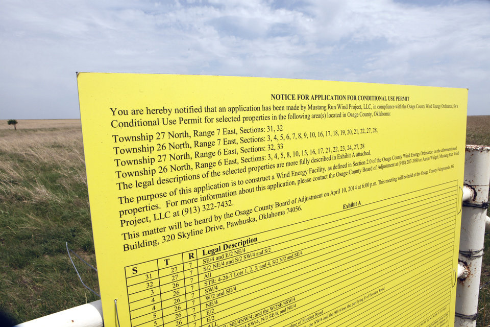 Photo - Notice on one of two wind farms for Osage County have drawn opposition from the Osage Nation, its Mineral Council and the Nature Conservancy, Wednesday, May 21, 2014.  Photo by David McDaniel, The Oklahoman