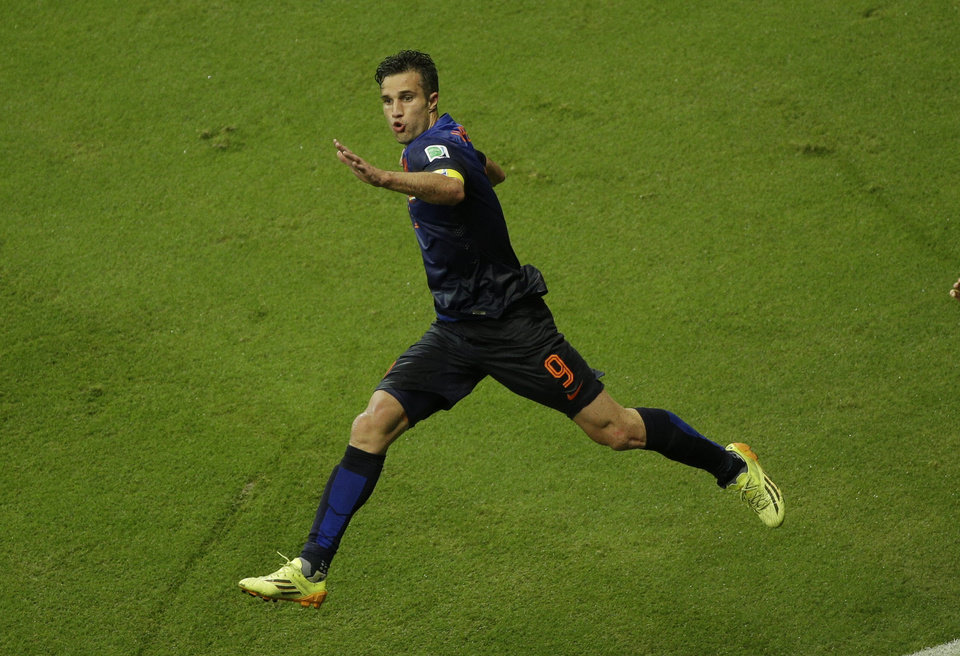 Photo - Netherlands' Robin van Persie celebrates after scoring a goal during the group B World Cup soccer match between Spain and the Netherlands at the Arena Ponte Nova in Salvador, Brazil, Friday, June 13, 2014.  (AP Photo/Christophe Ena)